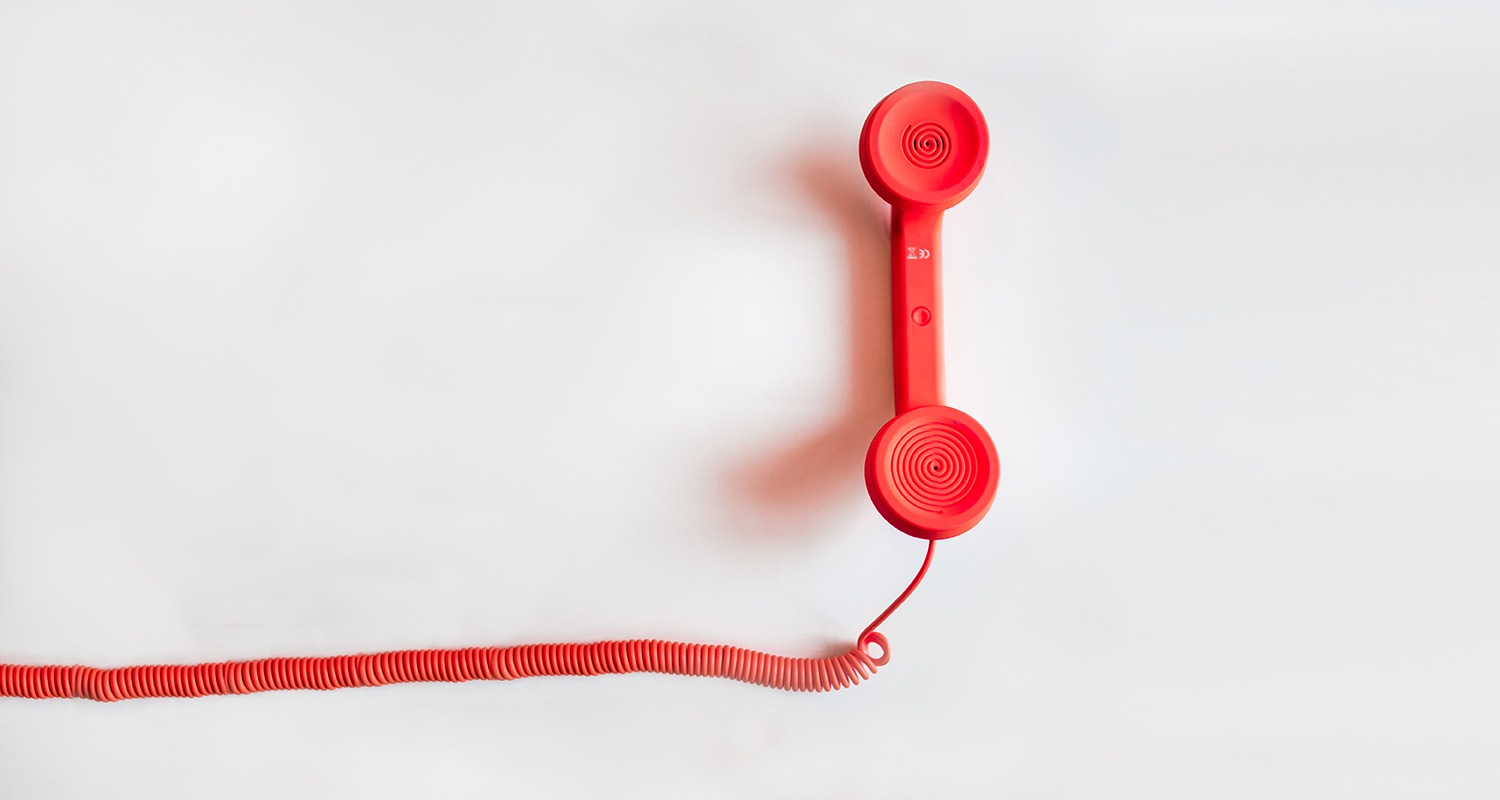 Red telephone receiver with cable