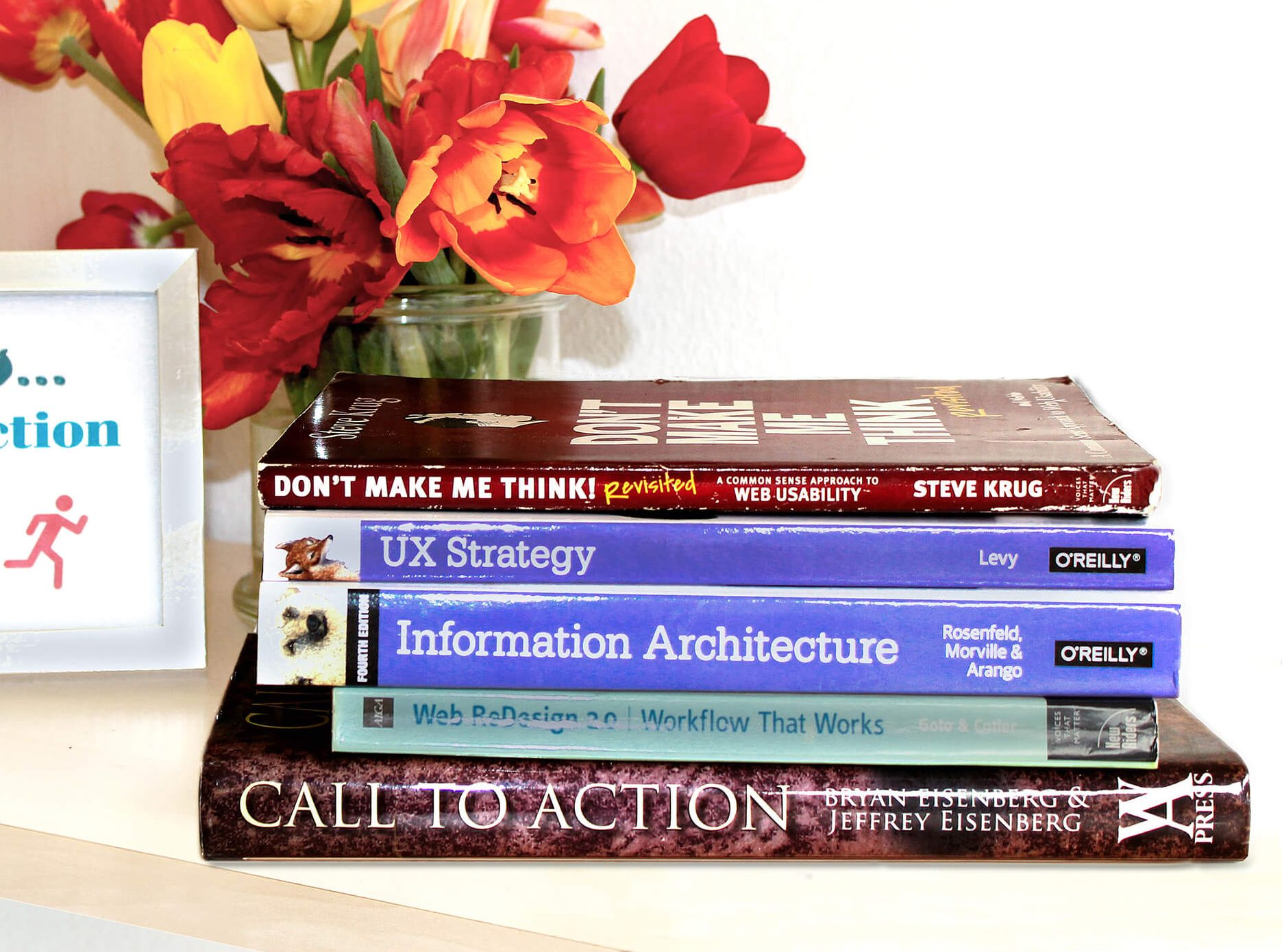 A pile of website UX books