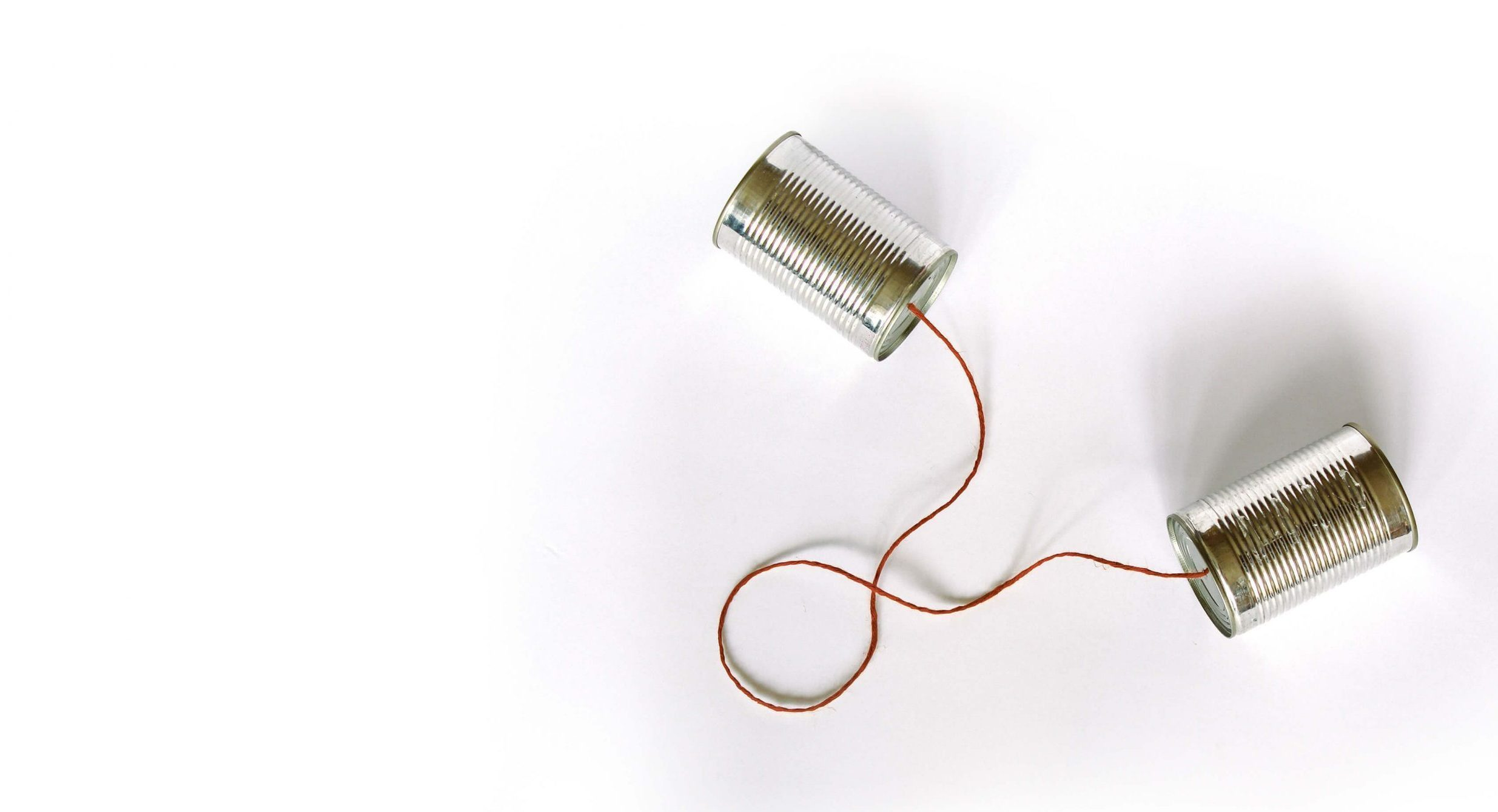 Telephone cans with red rope