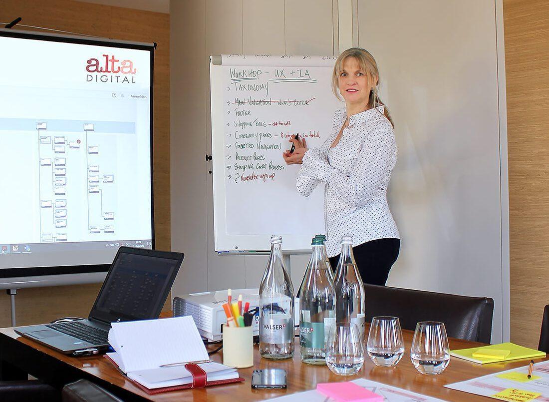 Tamara Warren at flip chart in meeting room