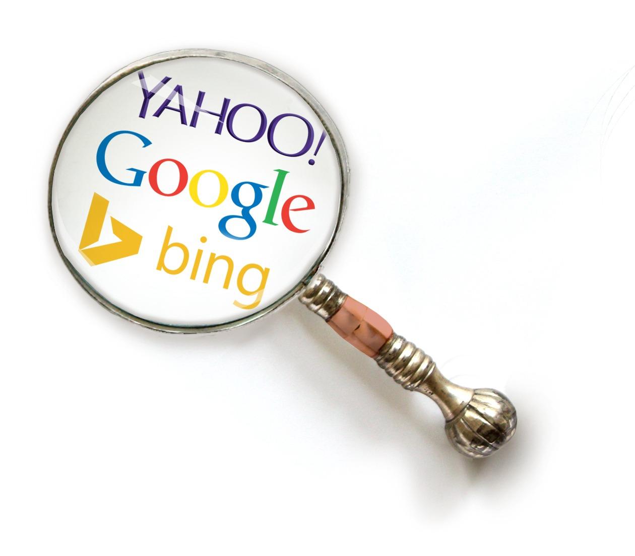 Magnifying glass with Google, Yahoo & Bing logos